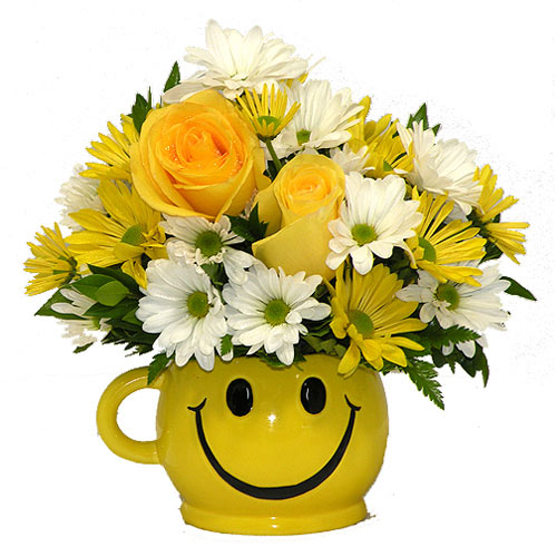 There are probably a million reasons this is such a popular bouquet. Of course, there are probably just as many reasons to send this cheerful arrangement. Full of happy flowers, this ceramic happy face mug will bring smiles for years to come. Especially when filled with that first cup of morning coffee or cocoa!<br/><br/>